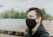 Load image into Gallery viewer, Model wearing the black commuter face mask