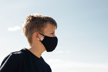 Load image into Gallery viewer, Youth model wearing the learner face mask in black