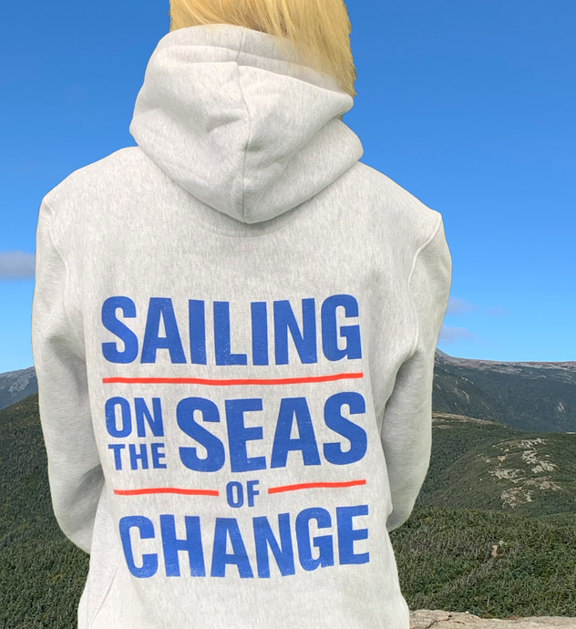 Sailing on the Seas of Change grey sweatshirt with blue lettering