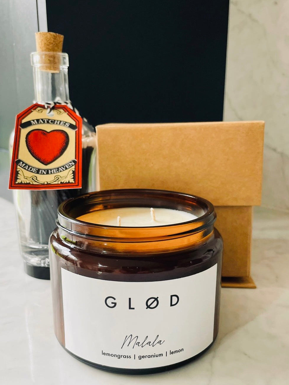 Large scented soy candle and matches in a bottle