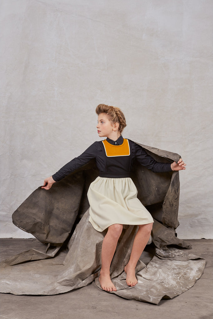 Girl wearing Hilda.Henri wool jumper - in set of Hilda.Henri campaign shooting. Sustainable and extraordinary kids`designer clothing made in Austria
