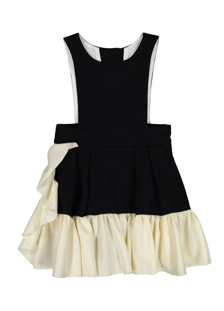 Wool Ruffle Dress by Hilda.Henri in black with contrasting asymetric white ruffle.