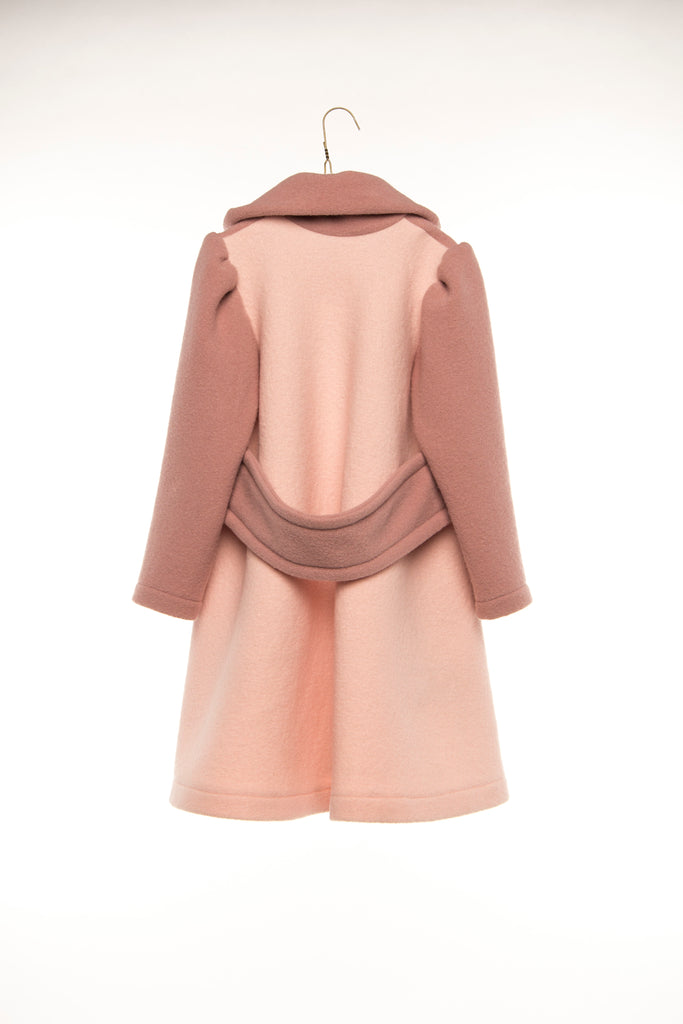 Hilda.Henri`s bicolored wool coat in oldrose and softpink with a belt in the back - viewed from the rear