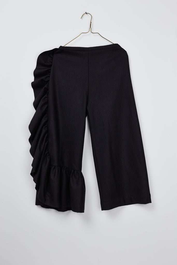 girl`s black wool pant with asymetric ruffle by Hilda.Henri