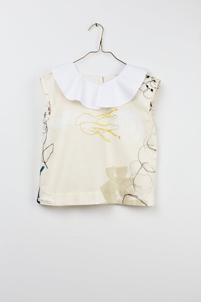 Sleeveless girl`s blouse with artistic print and white collar