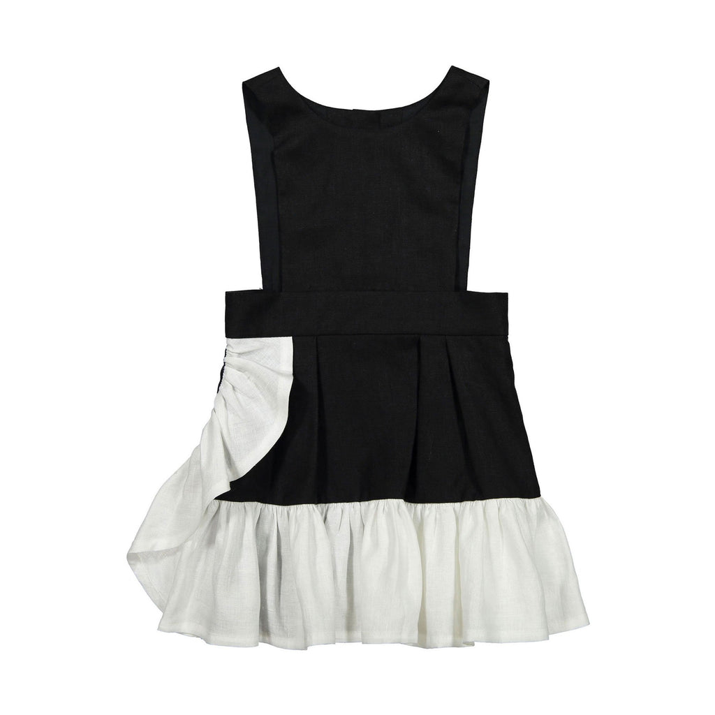 Linen Ruffle Dress by Hilda.Henri in black with contrasting asymetric white ruffle aside and at hem.