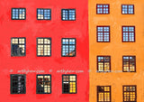 bright red and dark yellow building window to the world reflections collection