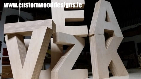 heavy cut out lettering custom wood designs sign specilaists dublinb manufacturer cnc machine sign  shop retail signs cut out wooden lettering custom wood designs irealnd beautitul irish signs maker dublin ireland cut out solid timber