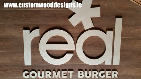 cut out lettering specialists dublin irealnd sign  shop retail signs cut out wooden lettering custom wood designs irealnd beautitul irish signs maker dublin ireland cut out solid timber