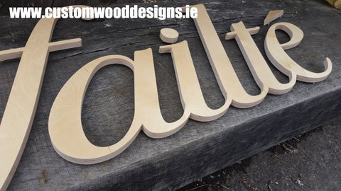 failte sign cut out letter wooden sign  shop retail signs cut out wooden lettering custom wood designs irealnd beautitul irish signs maker dublin ireland cut out solid timber