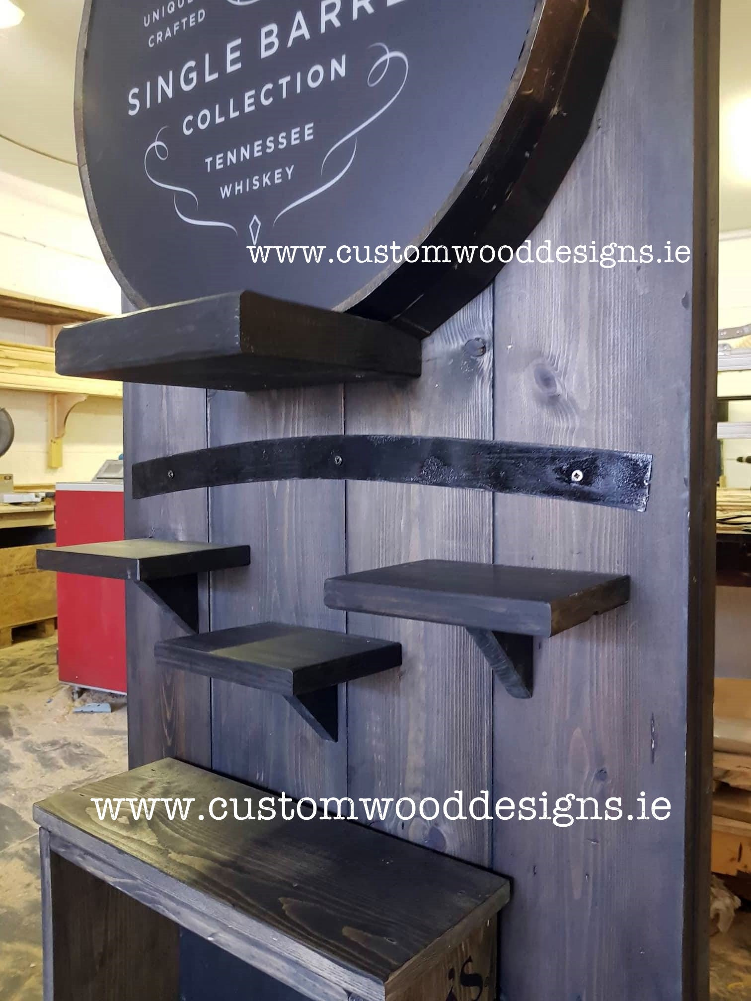 black rustic with light jack daniels point of sale retail display point of sale free standing europenan manufacturer custom wood designs Ireland Irish designs manufacture