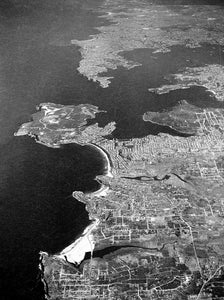 Aerial view of the Northern Beaches looking South. Above Curl Curl looking south towards, Manly and surrounding suburbs back towards the City and Bondi Beach. August 1937.
