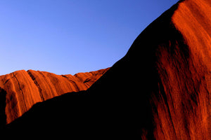 World Heritage listed Uluru in Australia's Northern Territory in part shadow. 26 December 2012