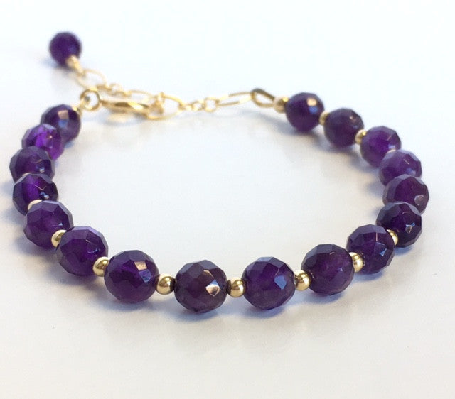 Faceted Amethyst in gold February birthstone bracelet.