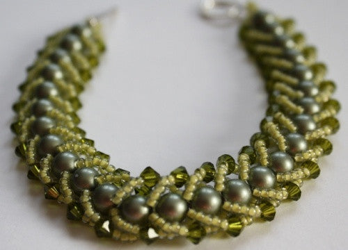 Gorgeous greens bracelet is made with swarovski crystals and pearls