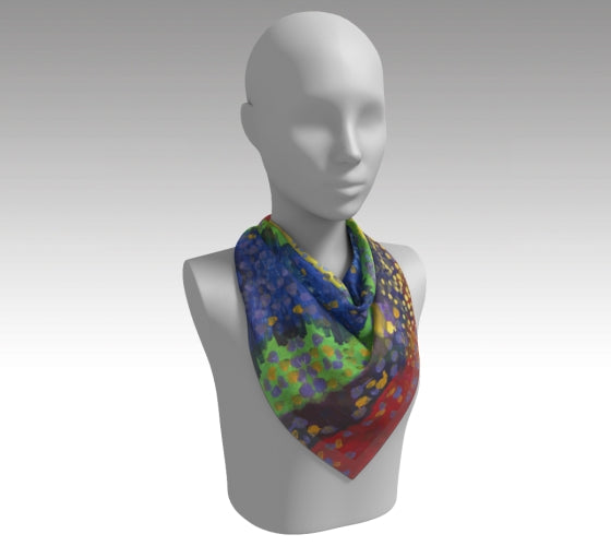 Mannequin wearing scarf depicting red, purple, green, and blue background with dots