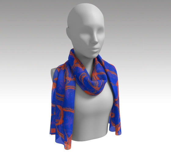 Mannequin wearing a royal blue scarf with orange large rings