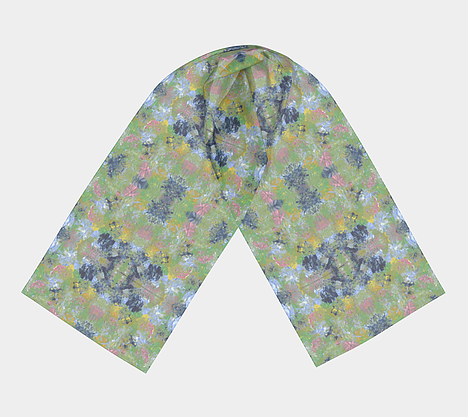 Flat lay view of scarf with spring flowers of pink, dark and light blue, green and yellow