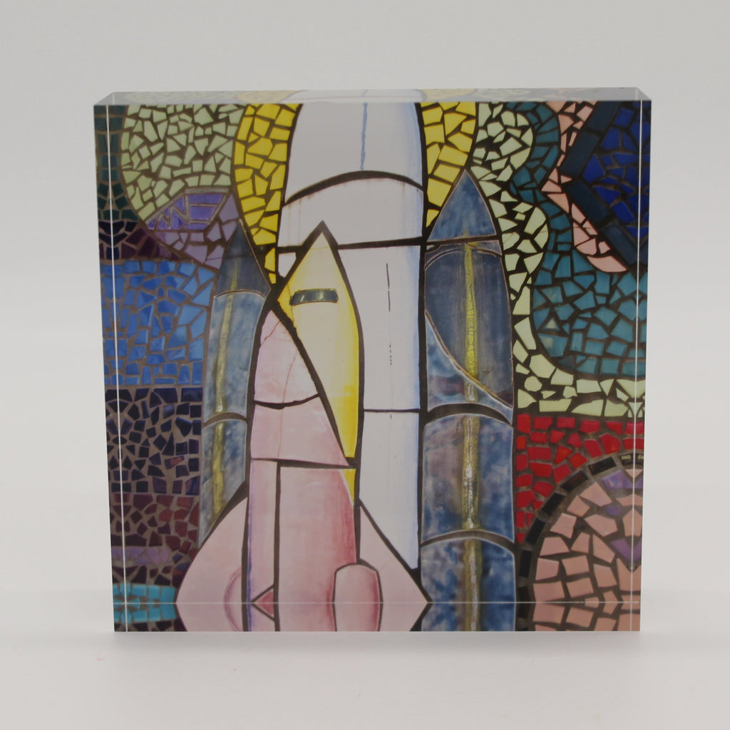Acrylic block of colored mosaic tiles depicting space shuttle