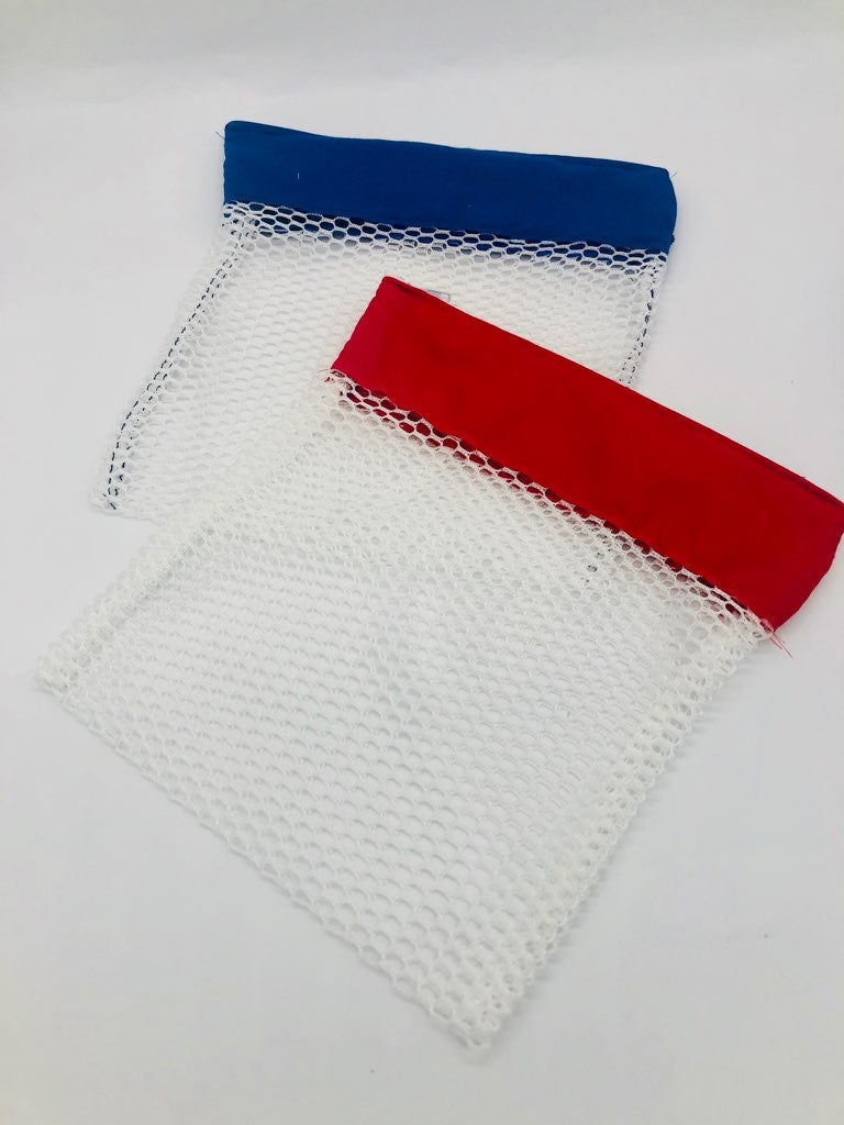 Two white mesh laundry bags, one with a blue fabric strip and one with a red fabric strip at the zipper
