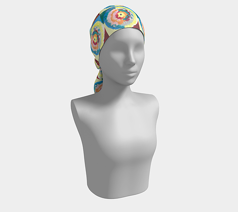 Mannequin wearing a colorful headscarf with circle within circle design with blue, green, orange, pink, yellow and red colors