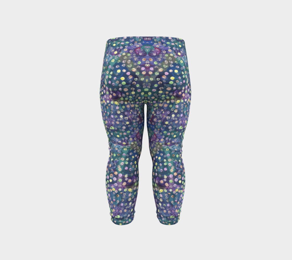 Back view of baby leggings with blue, green and purple swirl background and yellow, green and pink dots