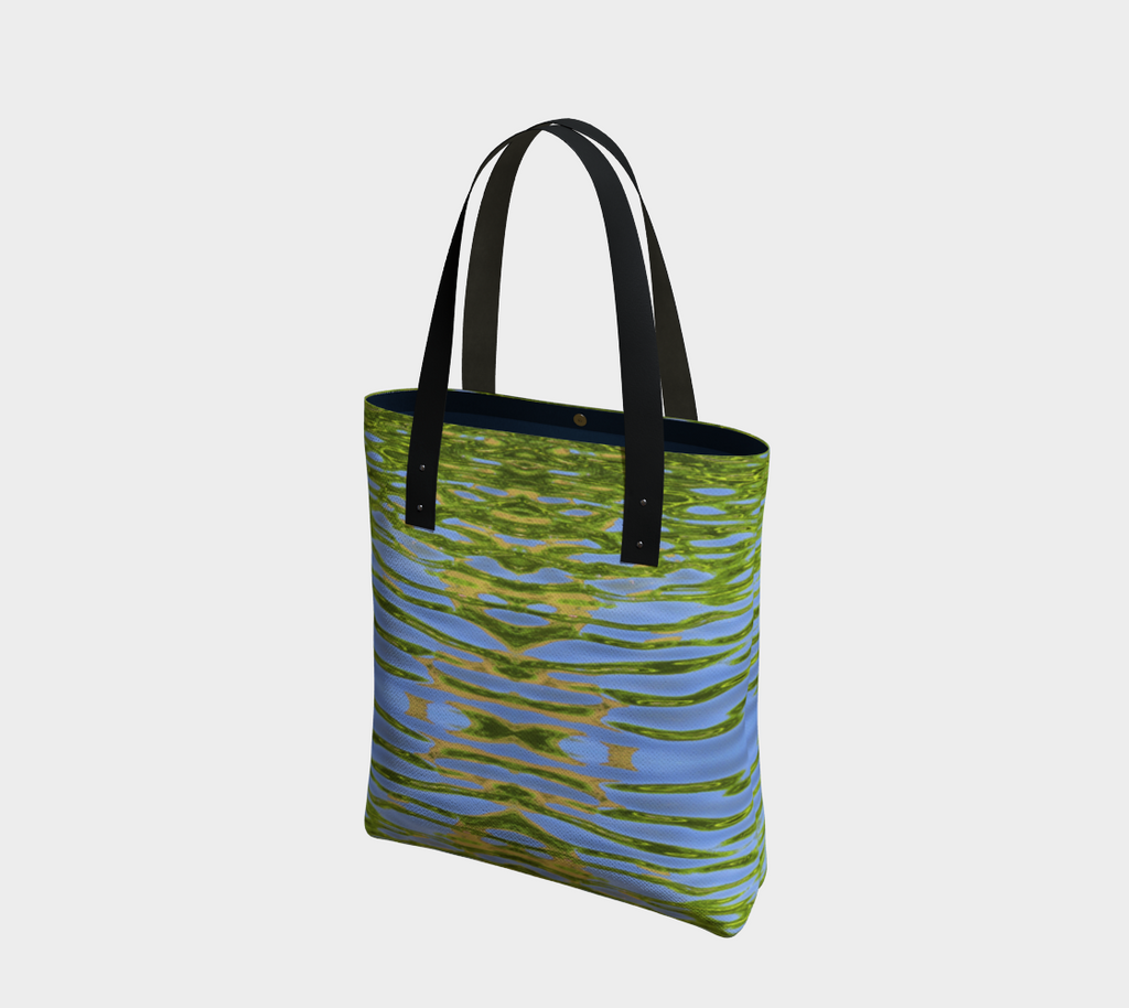 Lined Tote bag with vegan black leather straps and a magnetic clasp. The pattern is of reflecting water and leaves