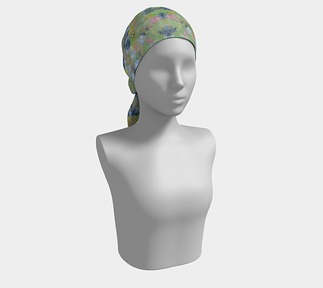 Mannequin wearing head scarf of spring flowers of pink, dark and light blue, green and yellow