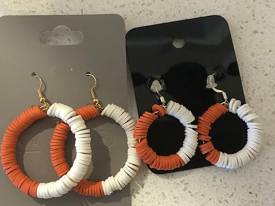 Orange and white colored fimo clay circle earrings