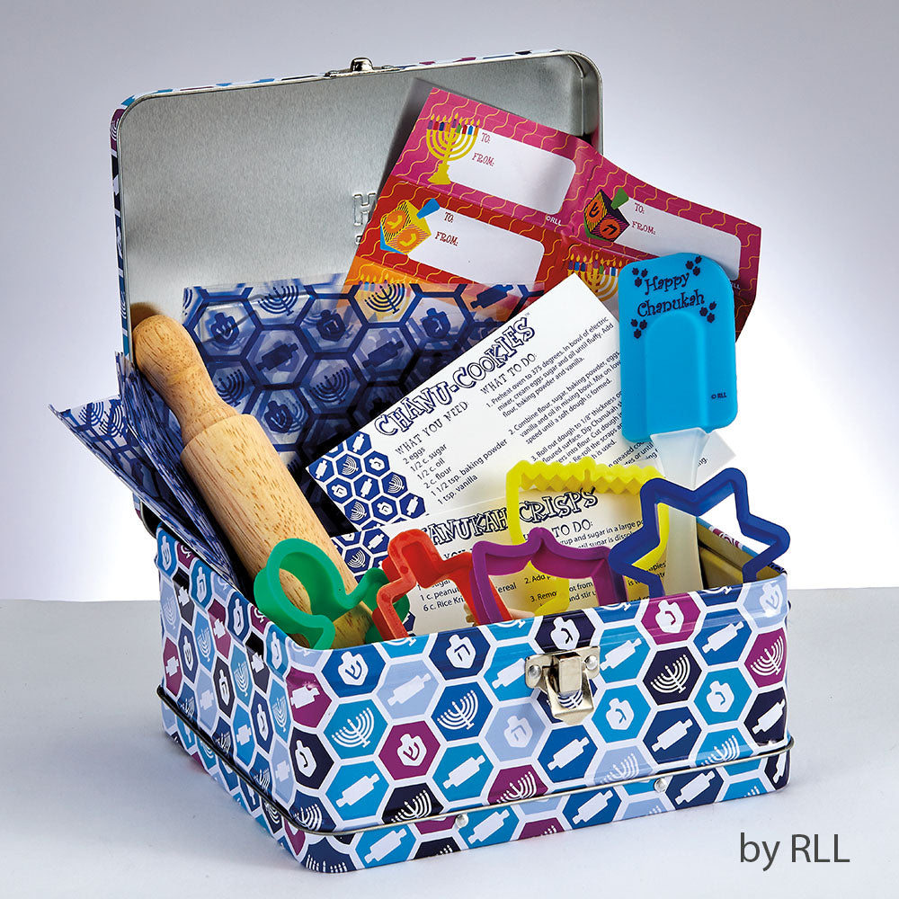 Chanukah baking set in open tin with rolling pin, dreidel and menorah design.  Kit includes bags, tags, rolling pin, spatula, cookie cutters and a recipe