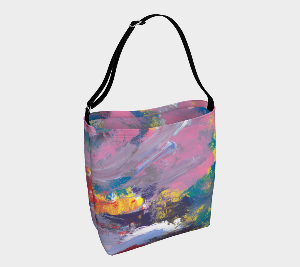 Crossbody tote with black strap depicting yellow, red, pink, turquoise, purple and lavender streak design