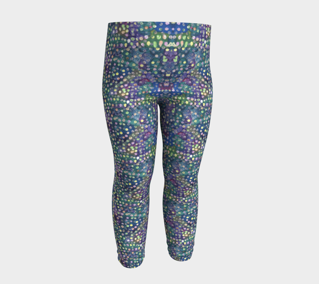 Front view of baby leggings with blue, green and purple swirl background and yellow, green and pink dots