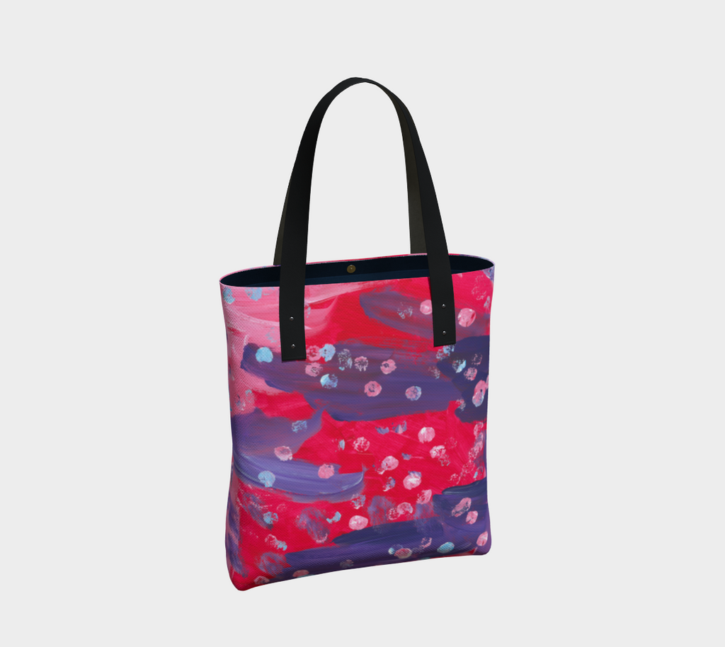 Tote bag with black double straps with abstract design of purple, pink and red paint with light blue dots