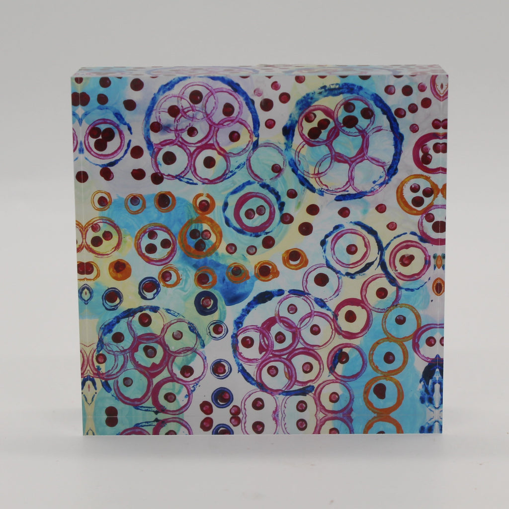 Acrylic block picture of blue, pink, and orange circles with maroon dots