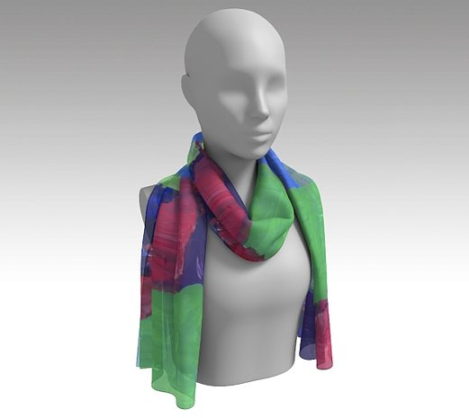 Mannequin wearing neck scarf with free-form squares in rows in colors of bright green, light, medium and dark blue, red, pink, purple and yellow.