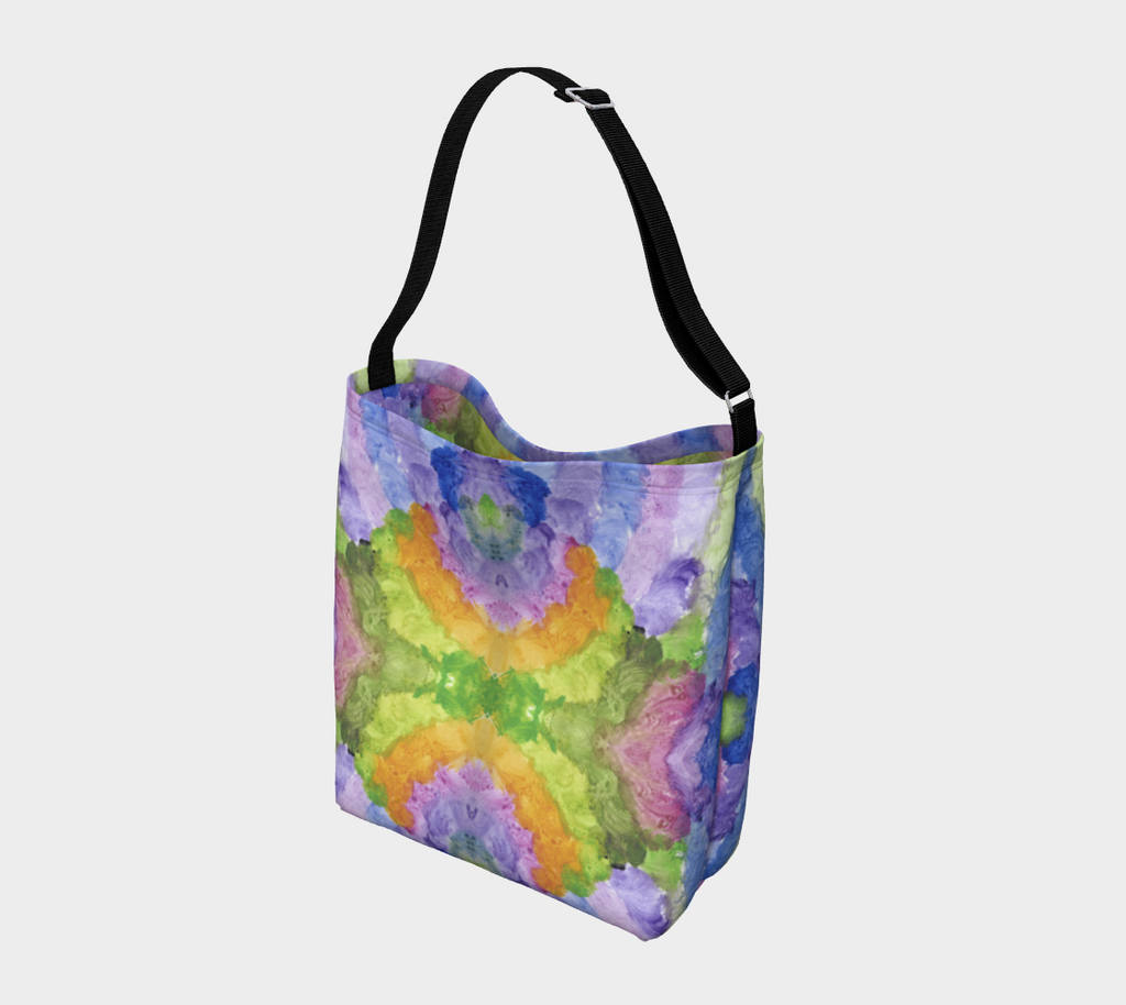 Crossbody bag with black strap with fluffy blue, lavender, orange and green swirls