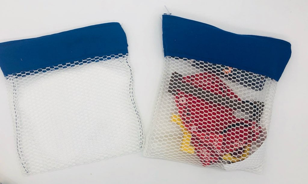 Two white mesh laundry bags with blue fabric strips at the zipper