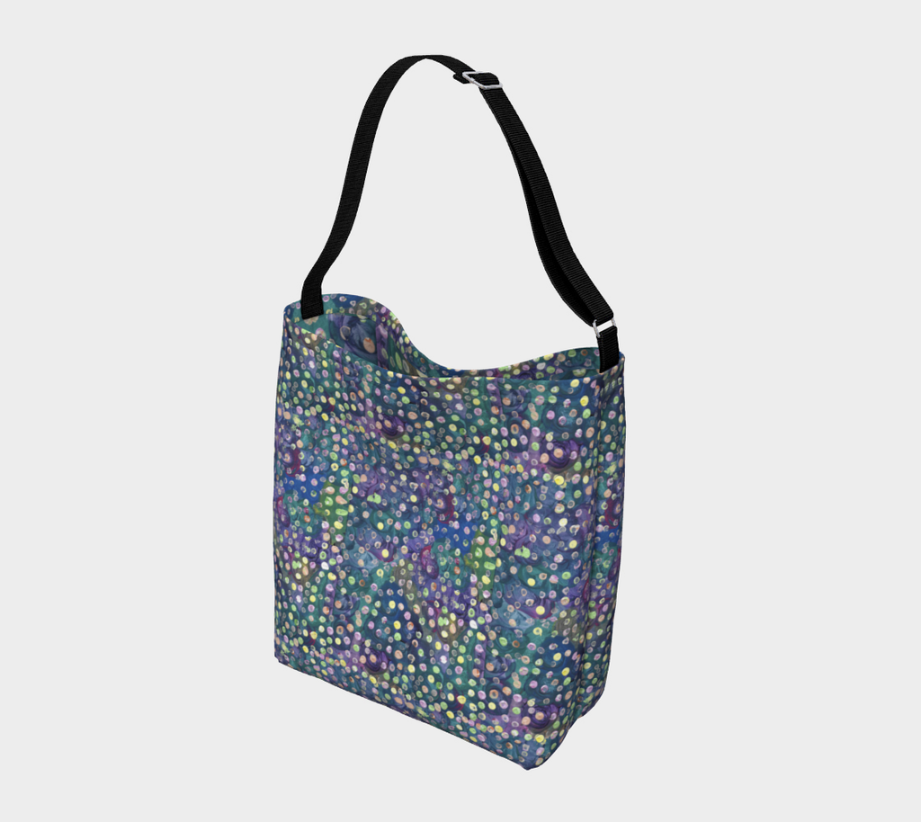 Crossbody bag with black strap and blue, green and purple swirl background with yellow, green and pink dots
