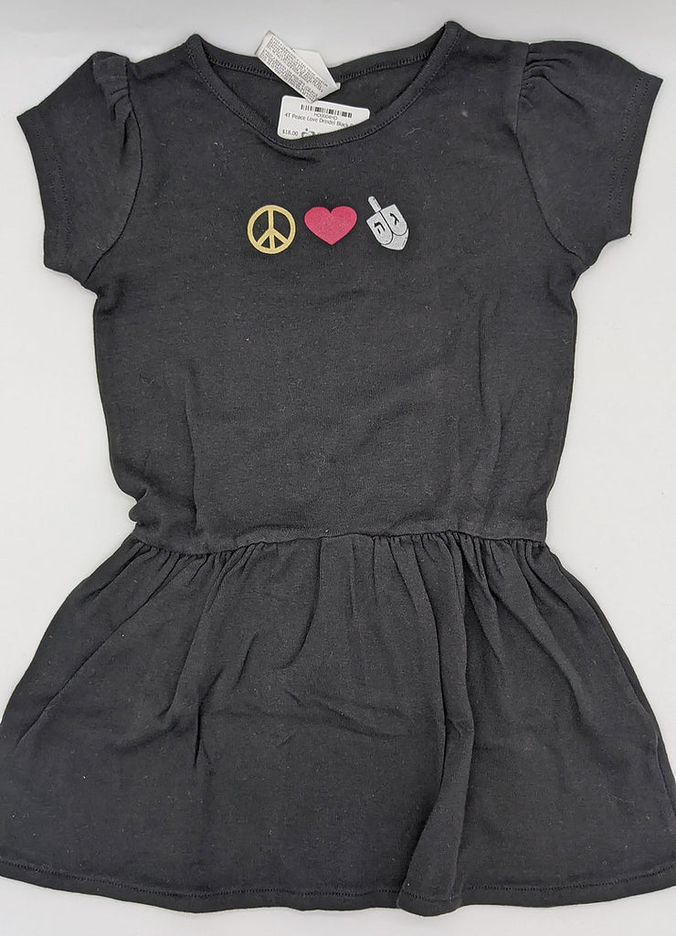 Black dress with ruffled bottom and yellow peace sign, red heart, and white dreidel across the chest