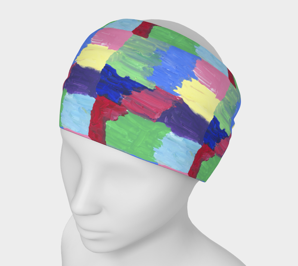 Mannequin wearing head band with free-form squares in rows in colors of bright green, light, medium and dark blue, red, pink, purple and yellow
