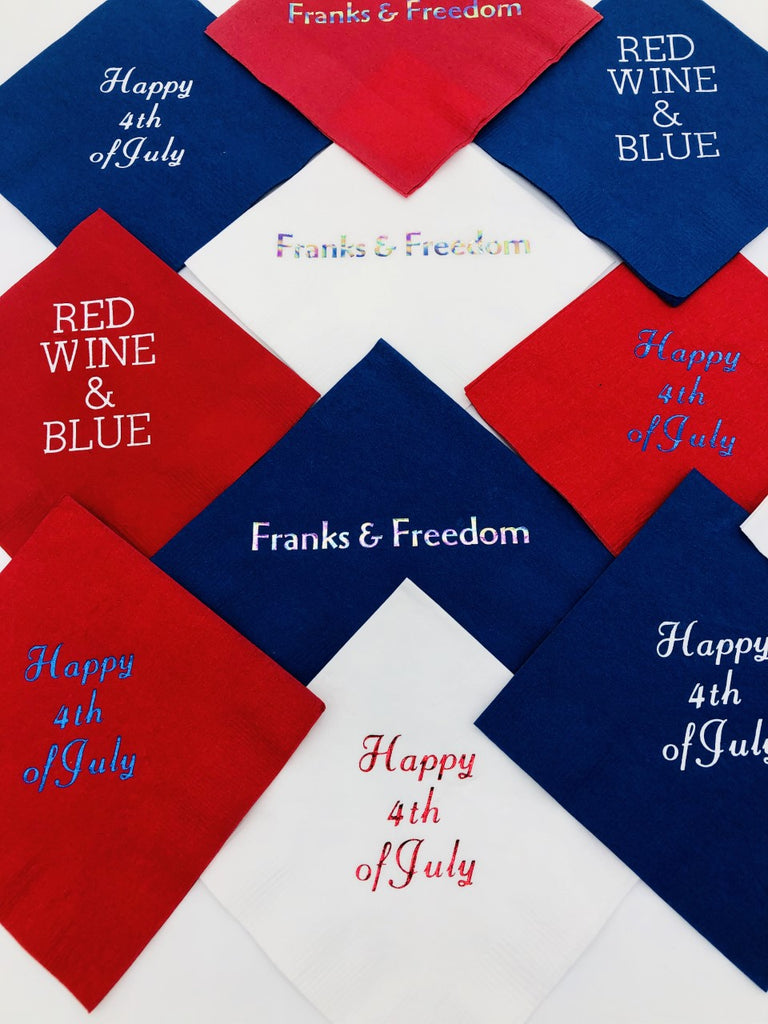 July 4th napkins showing various slogans including Happy 4th of July, Franks & Freedom and Red Wine & Blue in various red, white and blue variations