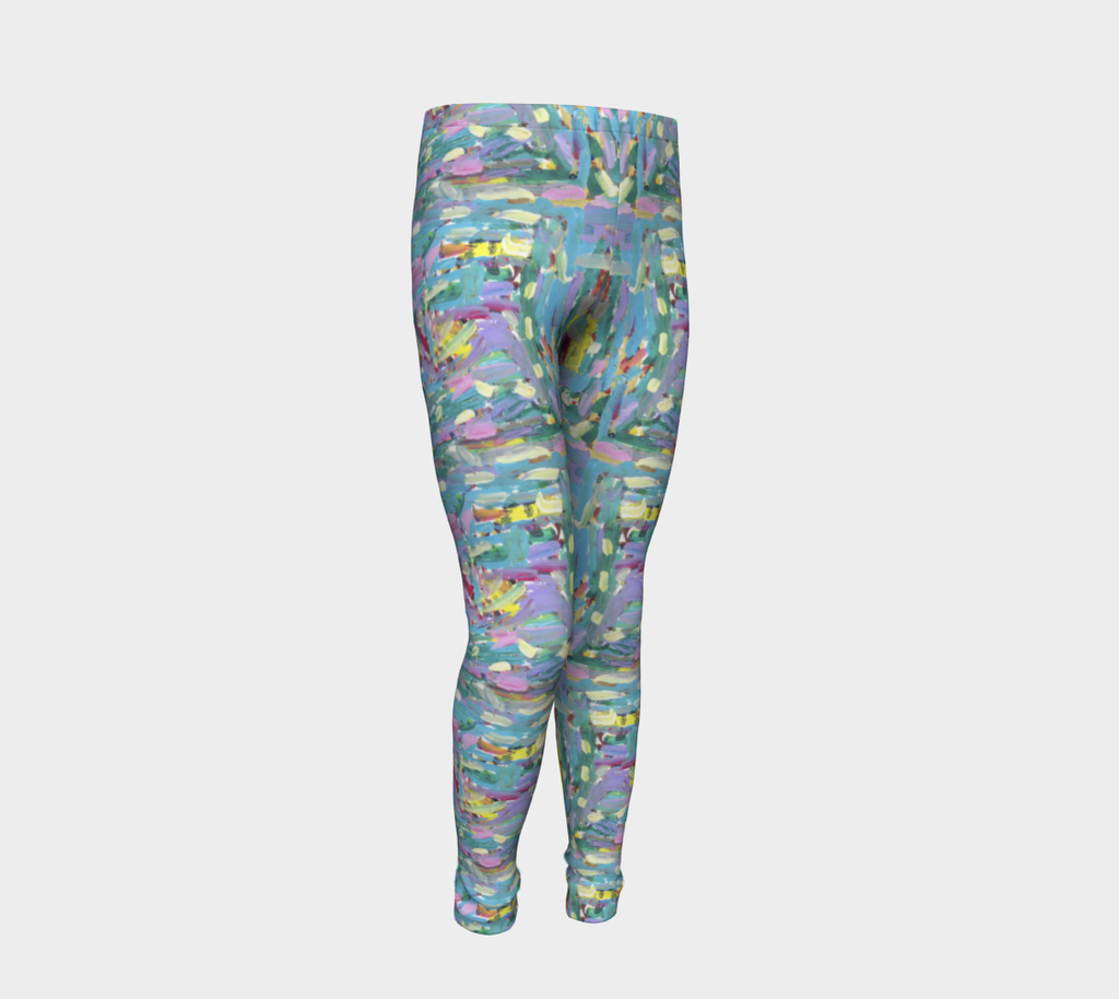 Front of youth leggings depicting pink, turquoise, lavender, green and yellow paint streaks