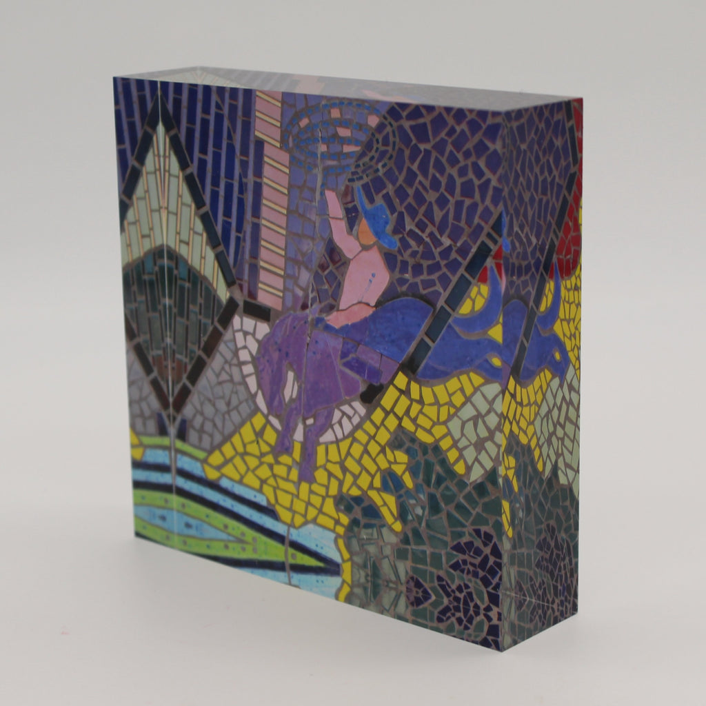 Tilted view of Acrylic block with mosaic tiles depicting a cowboy on a bucking bronco