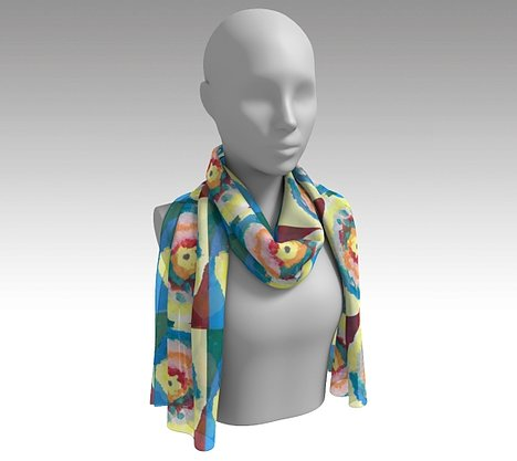 Mannequin wearing a colorful scarf with circle within circle design with blue, green, orange, pink, yellow and red colors