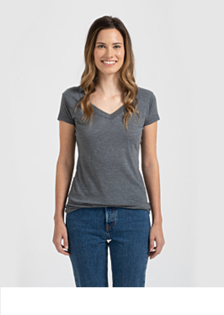 Stock photo model with brown hair smiling and wearing gray t-shirt and jeans