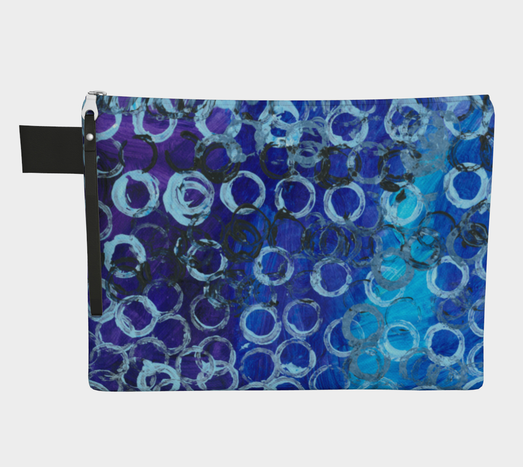 Zippered carryall bag depicting gradient blue background with white and black circles overlaid