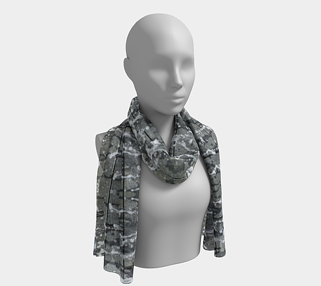 Mannequin wearing gray, white and black neck scarf with running water design