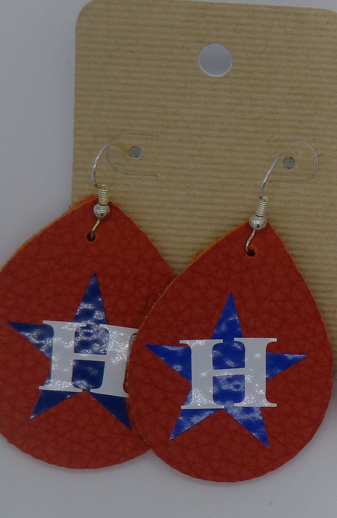 Tear drop shaped orange leather earrings with Houston Astros logo