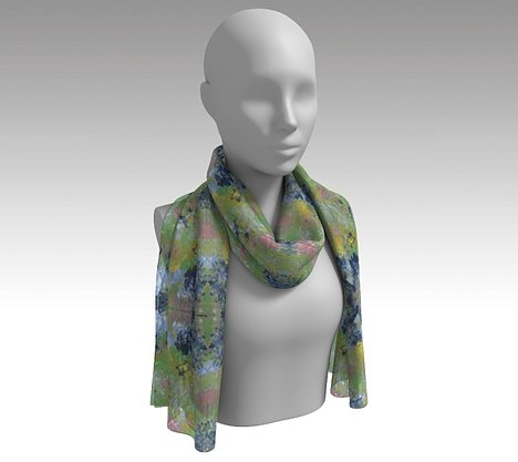 Mannequin wearing neck scarf with spring flowers of pink, dark and light blue, green and yellow