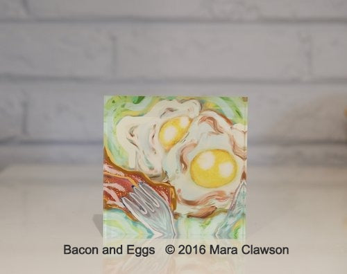 Acrylic block depicting 2 eggs sunny side up with side of bacon and a silver fork